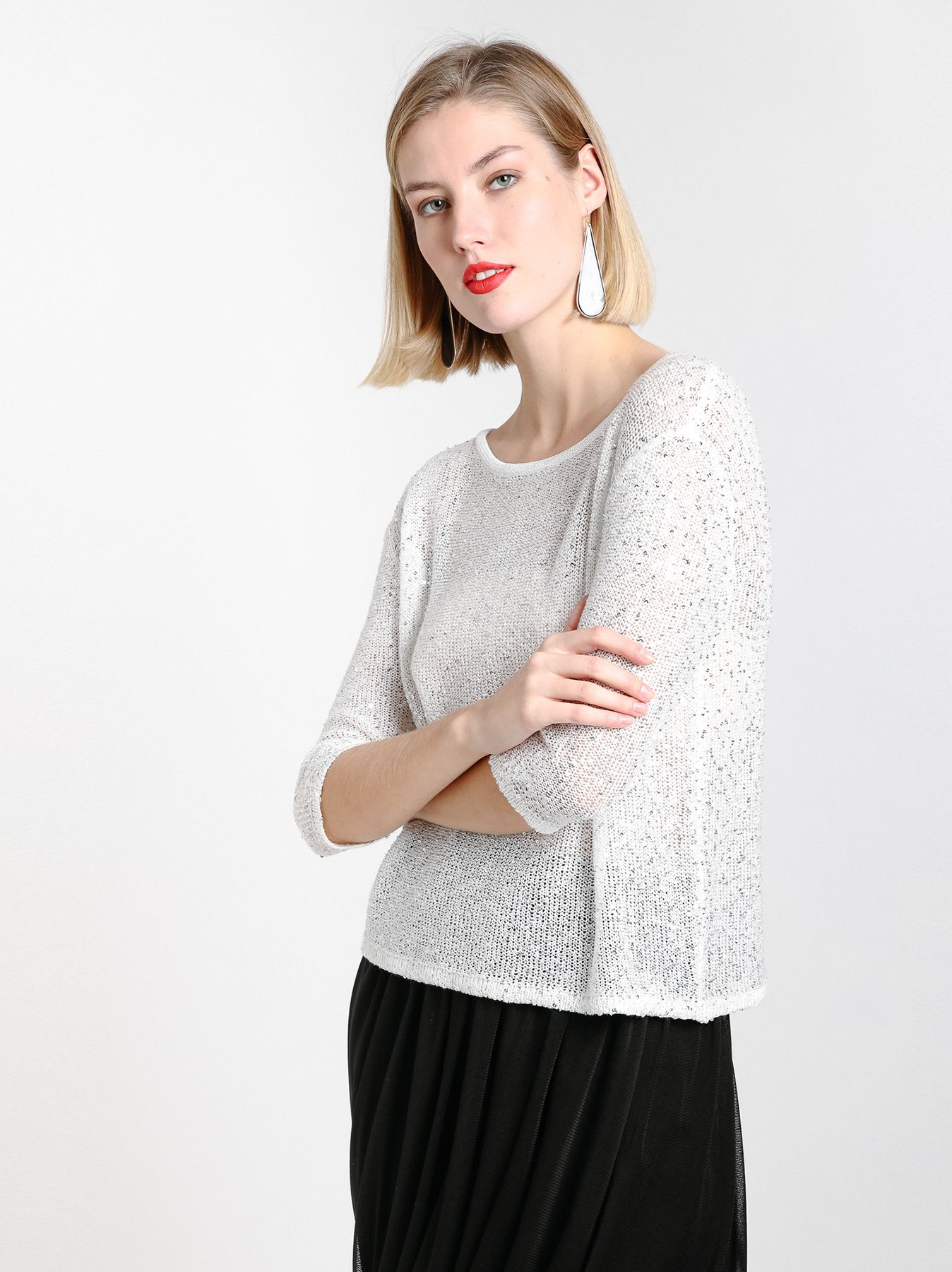 Suéter de lentejuelas